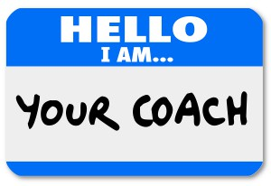 A namtag sticker with the words Hello I Am Your Coach